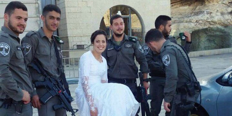 Bride poses at Western Wall with IDF soldiers