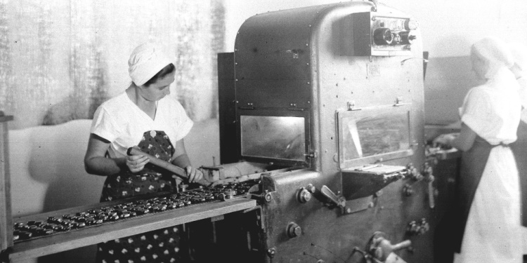 Workers make sweet treats at candy factory in Ramat Gan, Israel, 1938