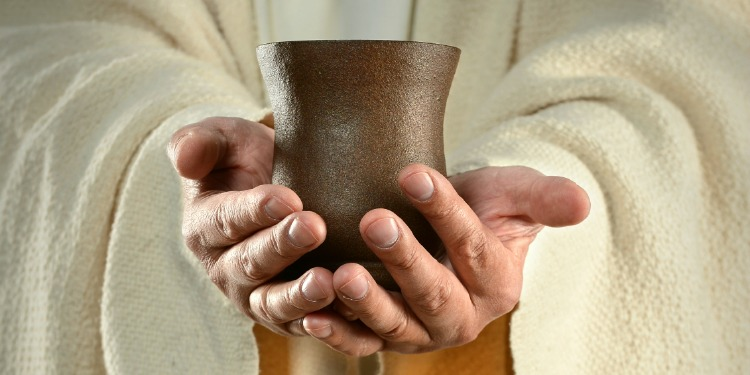 hands holding cup - download bible study on suffering