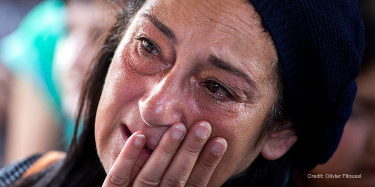 Jewish woman crying tears of relief after being rescued from anti-Semitism