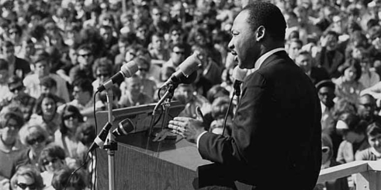 Photo of Martin Luther King from behind giving his famous I Have A Dream speech