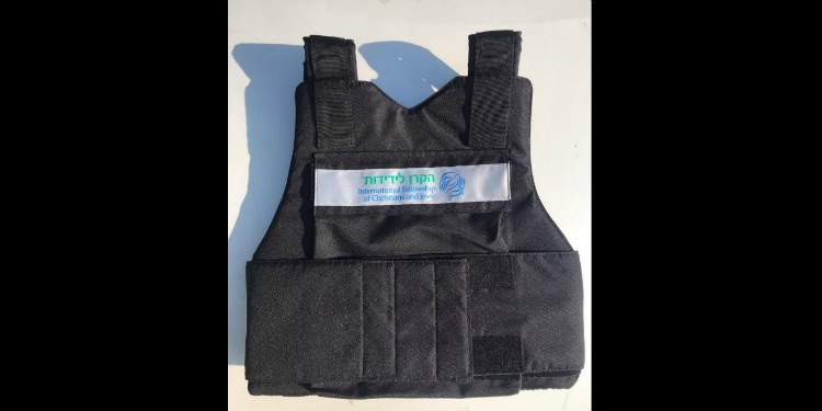 Israeli security vest with tag and IFCJ logo across the chest