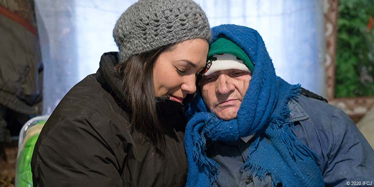 Yael with elderly woman Olga with dirt smudges on her face