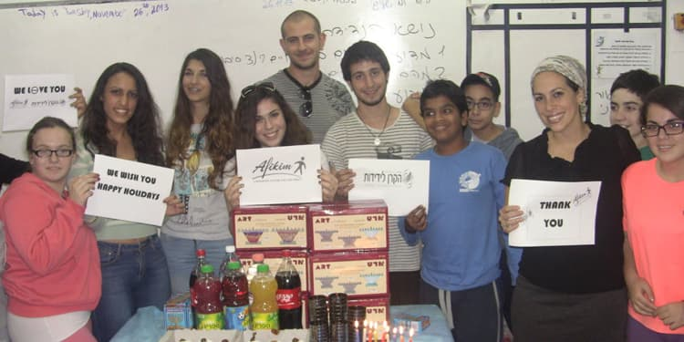 Yael Eckstein smiling for a photo at the Afikim Youth Center in Israel