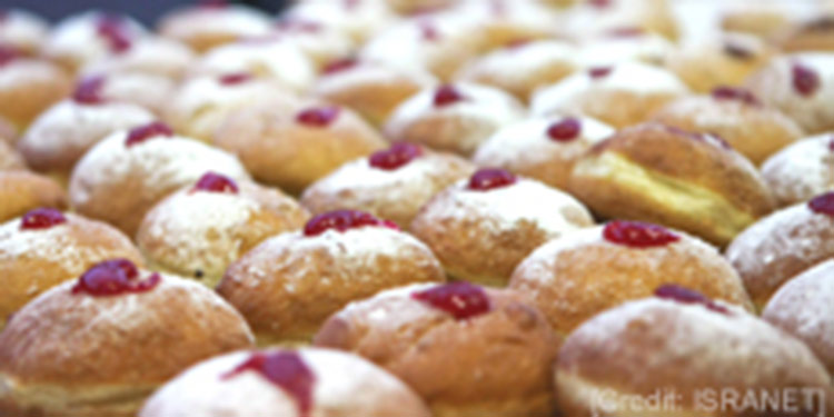 A row of olive oil cakes with powdered sugar on top for Hanukkah